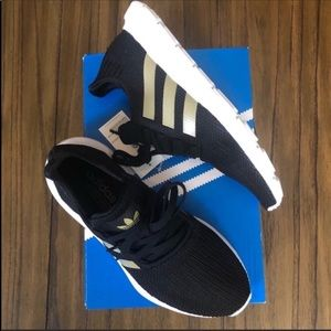 Adidas black and gold Swift Run sneaker shoe